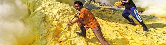 Sulphur miners at the Ijen crater lake - East Java, Indonesia