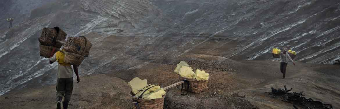 Sulphur miners at work at Ijen volcano