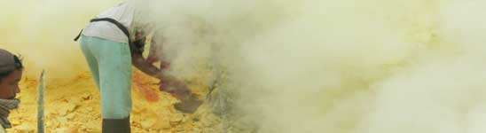 Sulphur miners at the Ijen crater lake in East Java, Indonesia